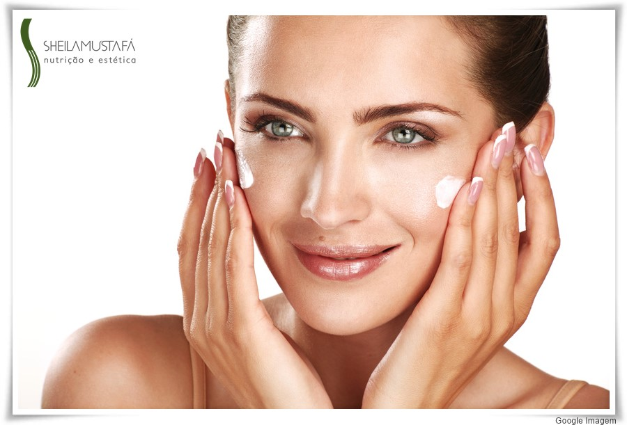 beautiful model applying cosmetic cream treatmen on her face